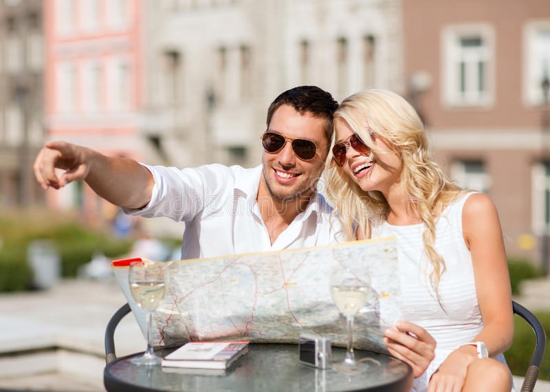 Couple with map in cafe stock photo