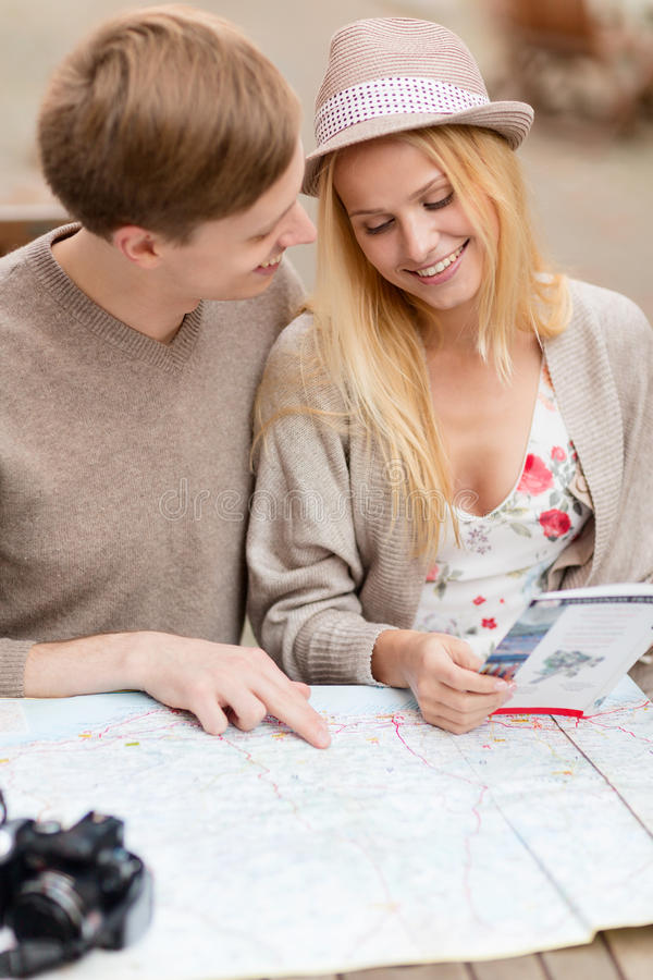 Download Couple With Map, Camera And Travellers Guide Stock Image - Image: 34602821