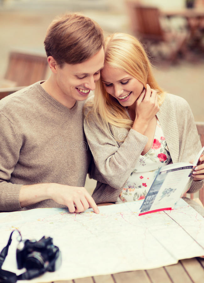 Download Couple With Map, Camera And Travellers Guide Stock Photo - Image: 40040842