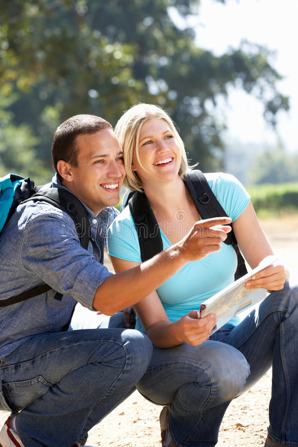 Download Couple With Map On Country Walk Stock Image - Image: 21237499
