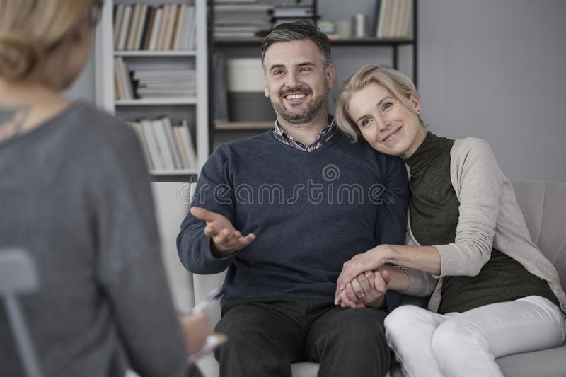 Couple during marital therapy. Middle-aged couple solving problems during marital therapy with a psychologist royalty free stock photos