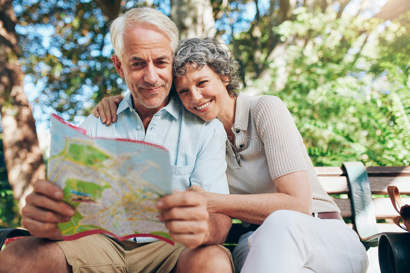 Couple of mature tourist on a vacation stock photos