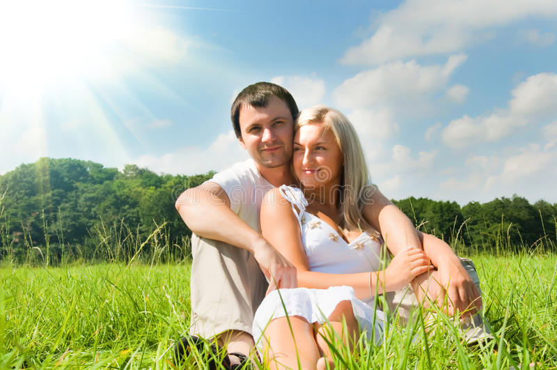 Couple on the meadow. Young love couple on the meadow royalty free stock photo