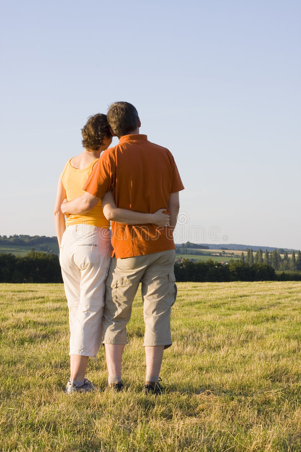Download Couple in a meadow stock photo. Image of green, nature - 5637834