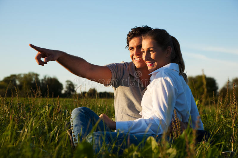Download Couple on meadow in sunset stock image. Image of evening - 12358735