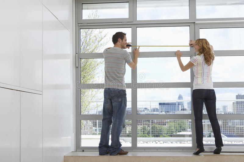 couple measuring apartment window stock photo image. Black Bedroom Furniture Sets. Home Design Ideas