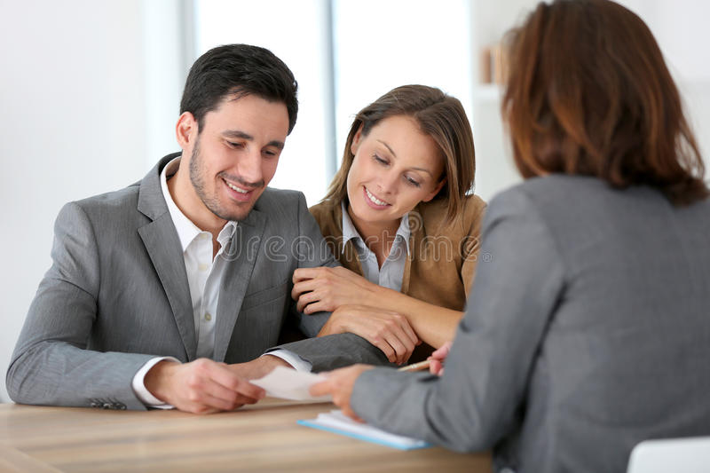 Couple meeting advisor at office. Couple meeting financial adviser for construction project royalty free stock image