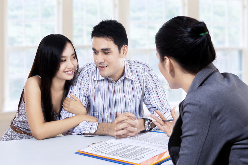 Couple meeting consultant for financial contract royalty free stock photos