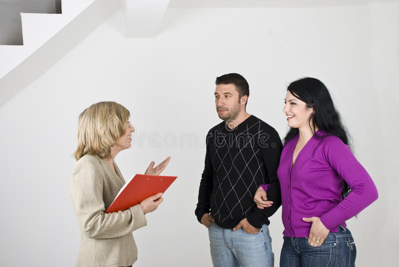 Couple meeting with estate agent royalty free stock image