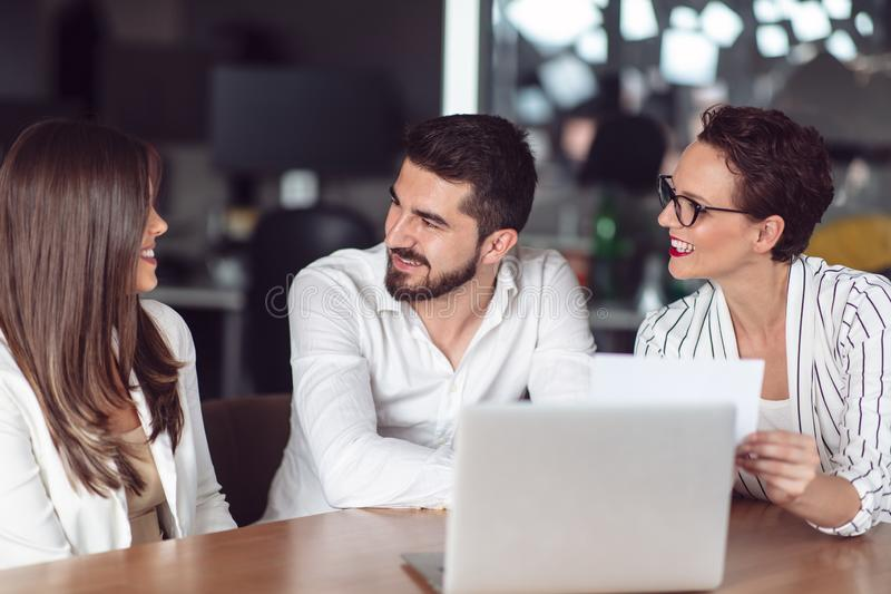 Couple meeting financial adviser for home investment contract royalty free stock images