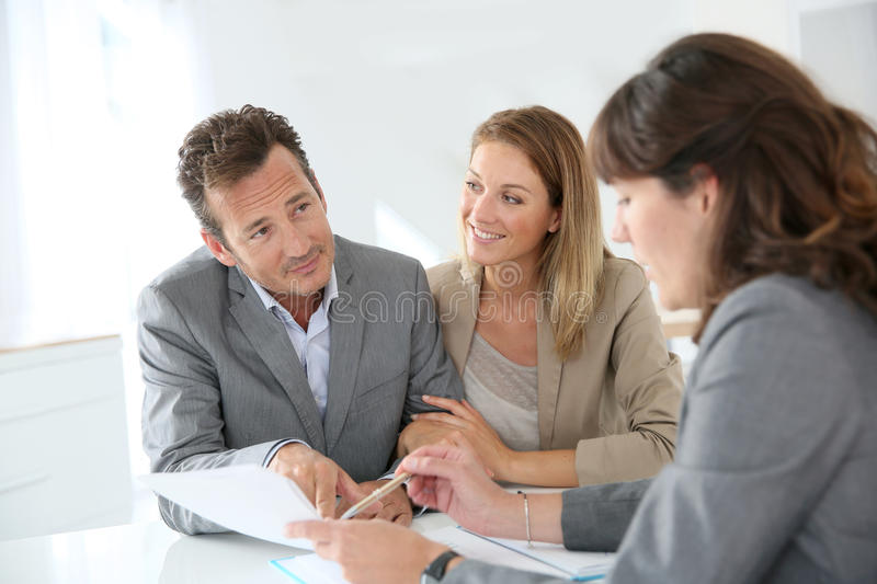 Couple meeting financial advisor. Couple meeting financial adviser for loan granting stock photography