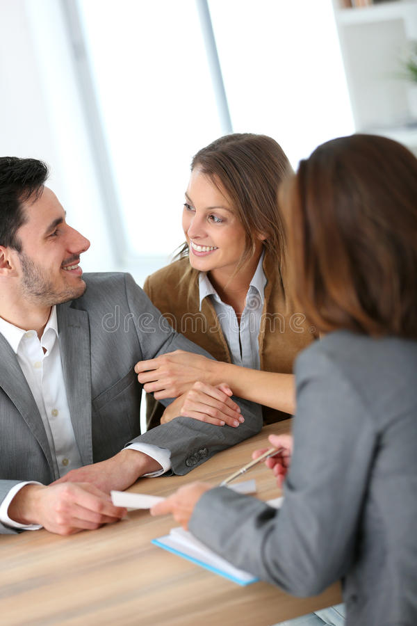 Couple meeting real-estate agent. Couple meeting financial adviser for construction project stock images