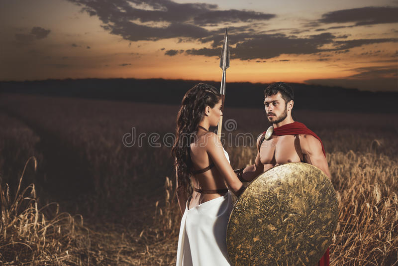 Couple meeting after war looking face to face. stock images