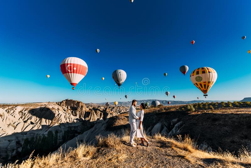 The couple meets the dawn. The man proposed to the girl. Family trip to Turkey. Couple at the balloon festival. Couple travels the royalty free stock images