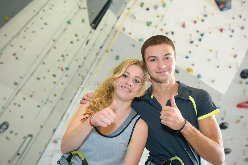 Couple men and women near climbing wall royalty free stock images