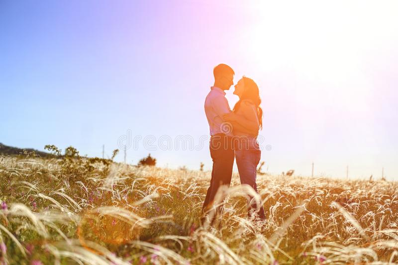 Couple man and woman relationship in nature in the setting sun stock photography