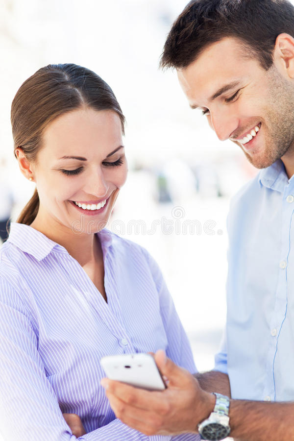 Download Couple with mobile phone stock photo. Image of texting - 32804692