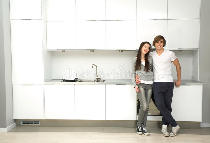 Download Couple in modern kitchen stock image. Image of estate - 12830751