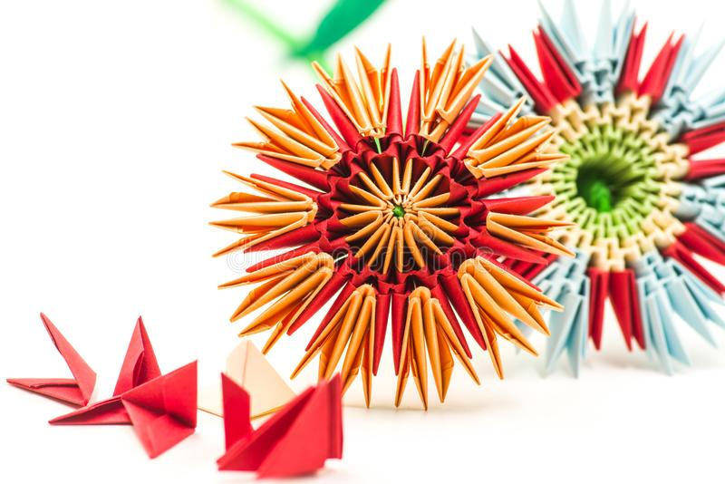 Two modular origami flowers with module blocks isolated on white background royalty free stock photo