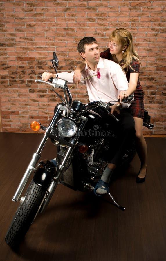 Couple on motorbike royalty free stock photos