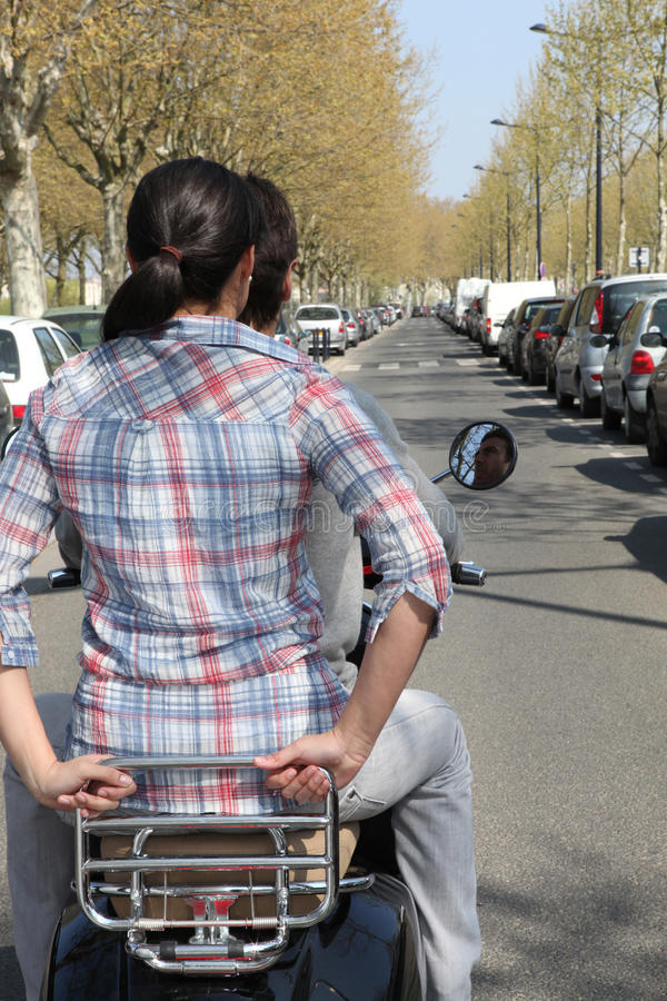 Couple on motorcycle without helmet stock image
