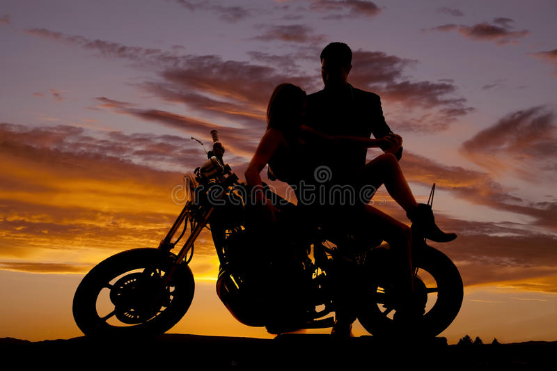 Couple on motorcycle her lean back him hold stock photos