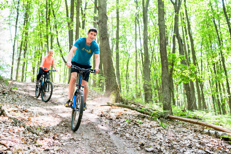 Couple on mountain bike bicycle royalty free stock photo