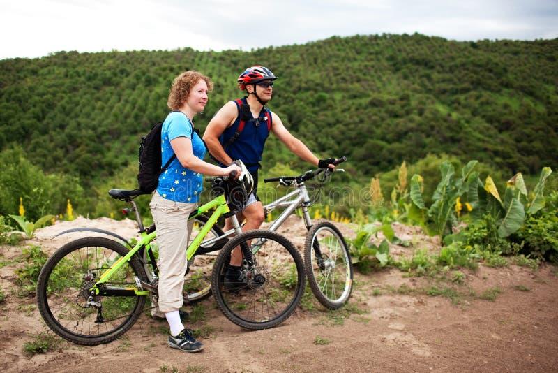 Couple mountain bikers royalty free stock photo
