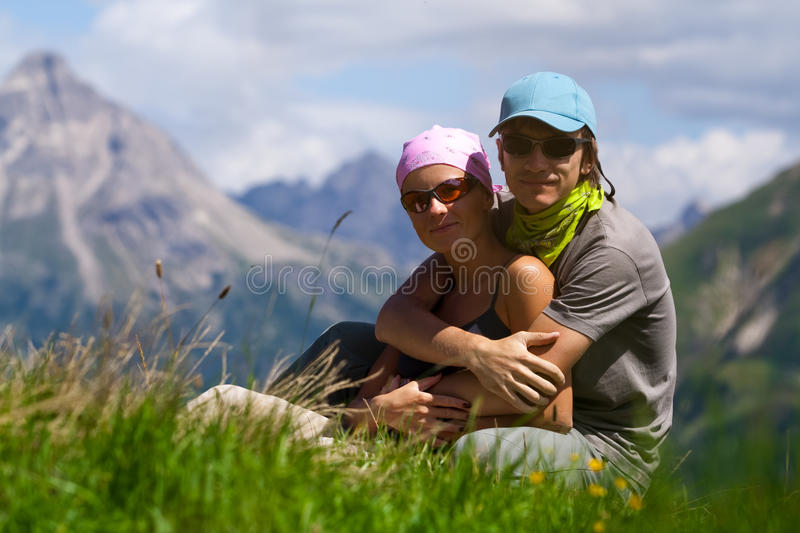 Couple In Mountains Looking At Camera Stock Photography
