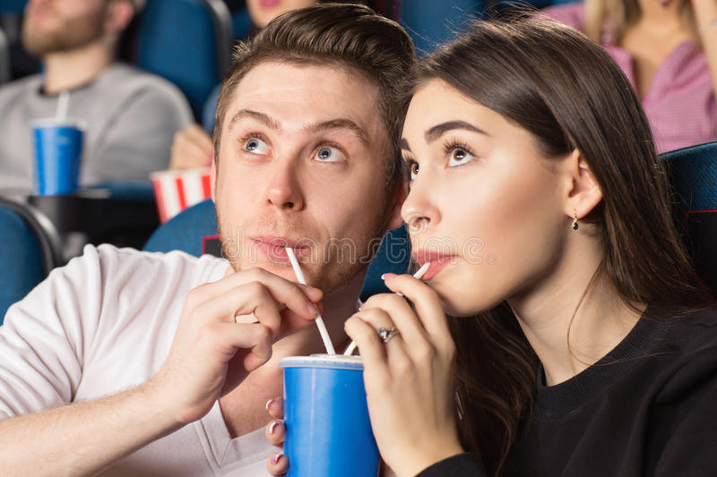 Couple at the movie theatre stock image