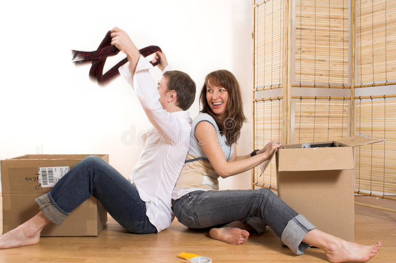 Couple moving in appartment royalty free stock images