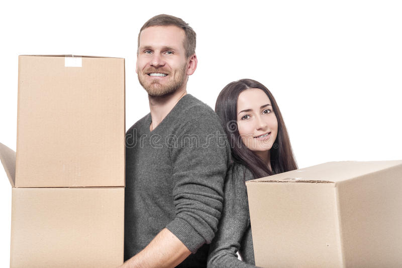 Couple with moving boxes stock photos