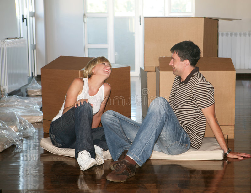 Couple moving house. Young couple in love moving house royalty free stock photo
