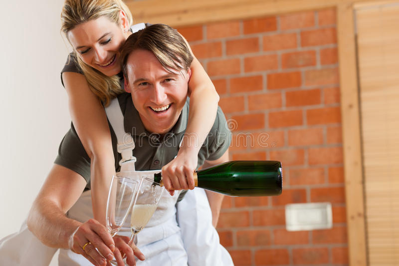 Couple Moving In New Apartment Renovating Stock Photos