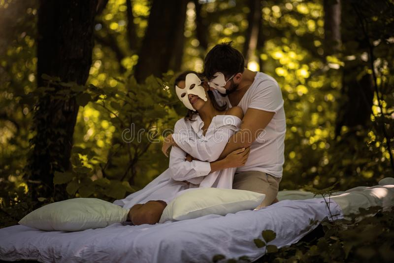 Couple in nature . Hidden face concept. stock photo