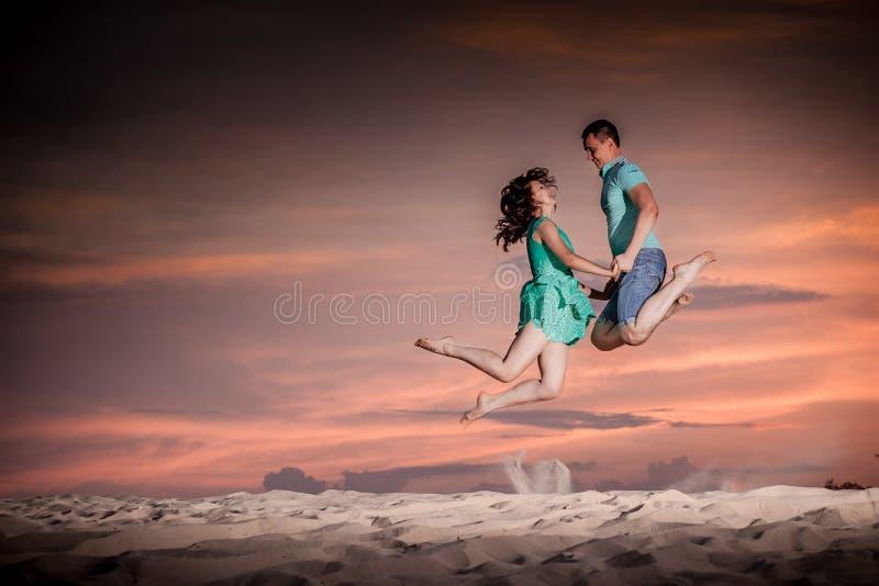 Couple, nature, jump, sunset stock image