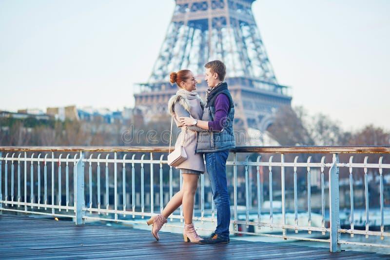 Couple near the Eiffel tower in Paris, France. Young romantic couple near the Eiffel tower in Paris, France stock photos