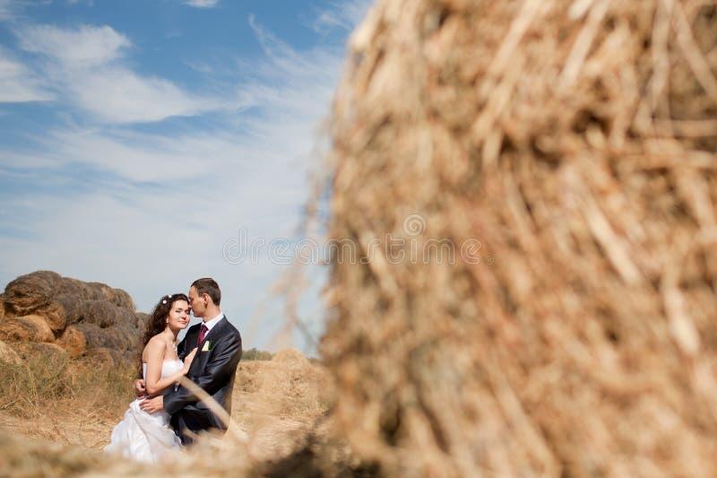 Couple near the hay stock photo
