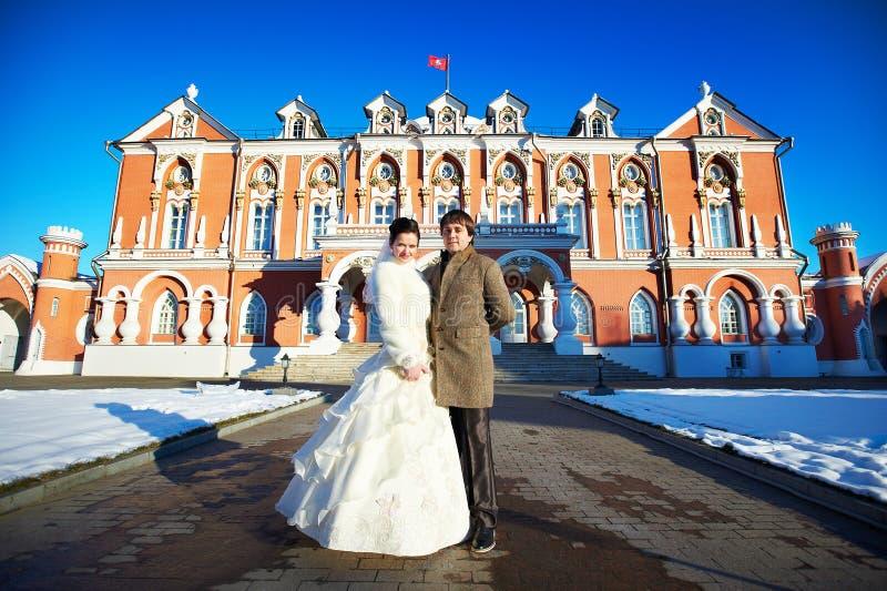 Couple near Petrovsky Putevoy Palace in Moscow. Happy couple near Petrovsky Putevoy Palace in Moscow stock photos
