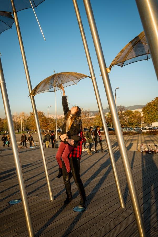 Couple near umbrellas in Thessaloniki royalty free stock photo