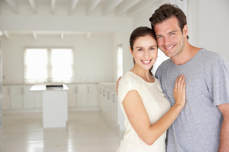 Couple in new home. Smiling at camera royalty free stock photography