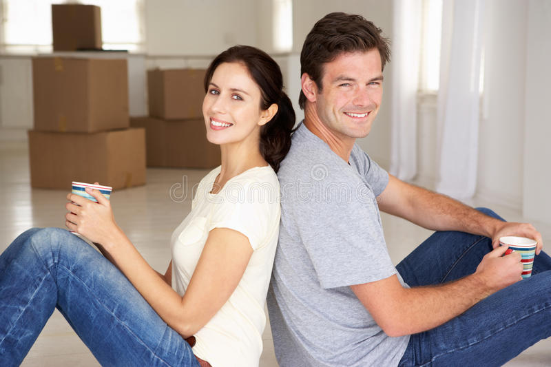 Couple in new home. Smiling at camera stock photo