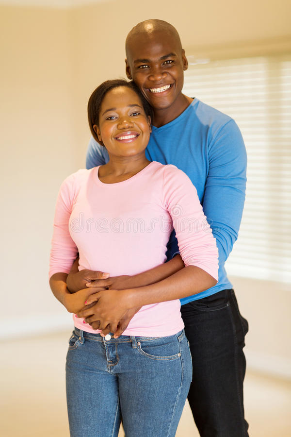 Couple new home. Portrait of happy young african american couple in new home royalty free stock images