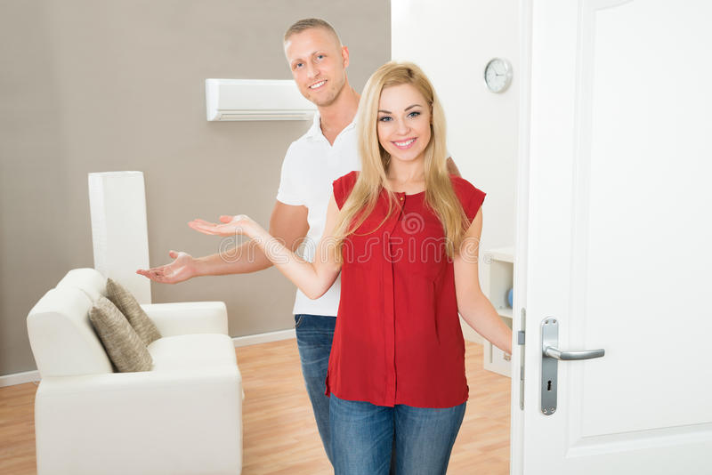Couple in new home. Portrait Of Young Happy Couple In New Home stock images