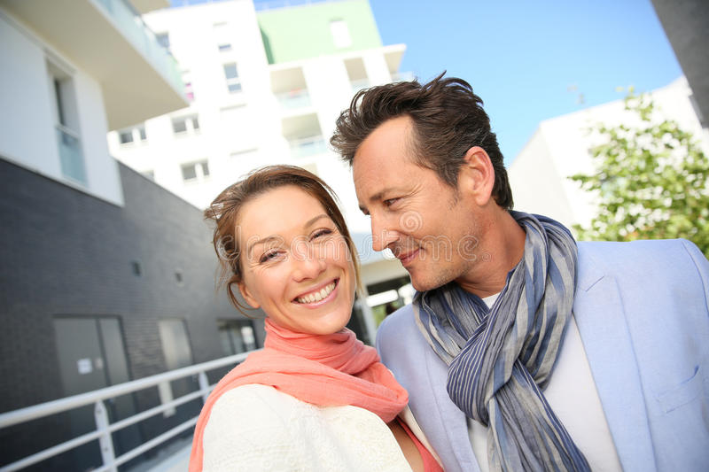 Couple in new residential area looking for an appartement. Couple looking for apartment to buy royalty free stock photo