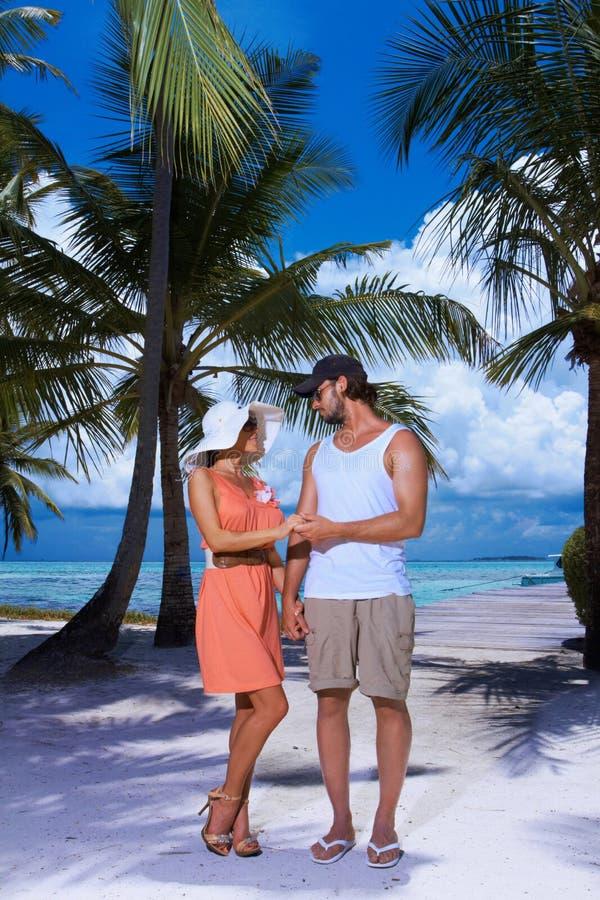 Couple Nex To Palm Tree Royalty Free Stock Photo