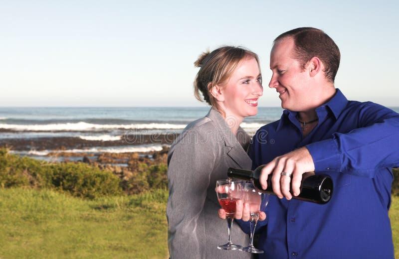 Couple next to the coast stock photography