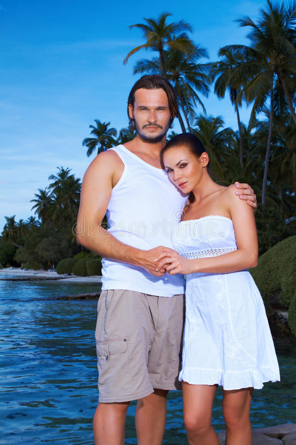 Download Couple next to Palm tree stock image. Image of beach - 14532297