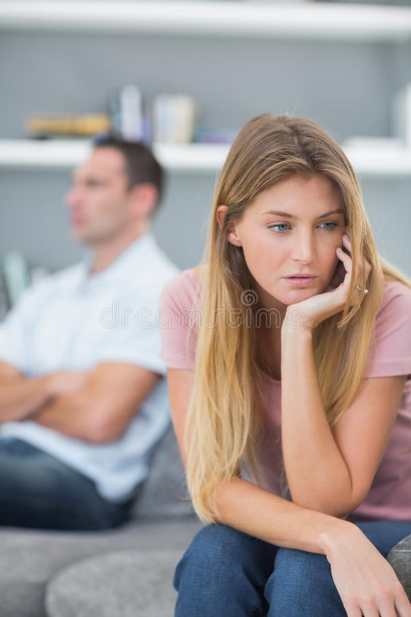 Couple not speaking after a fight on the sofa stock photo
