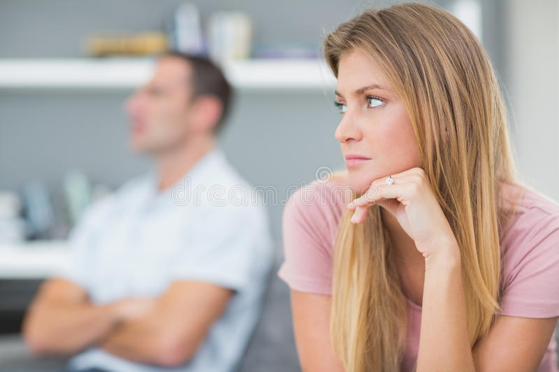 Couple not talking after a dispute on the couch stock photo